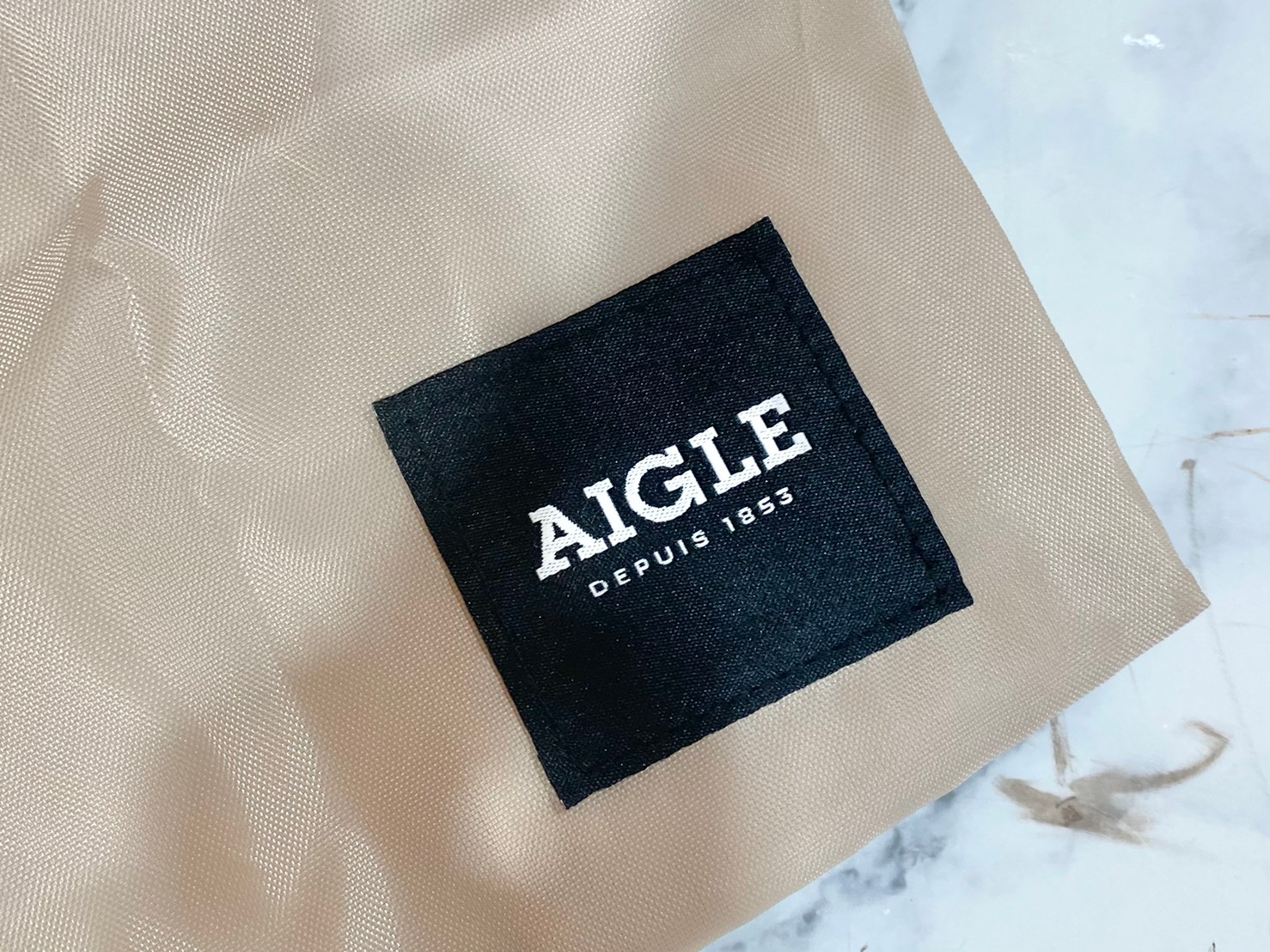 変身お買い物バッグのブランドロゴ画像
