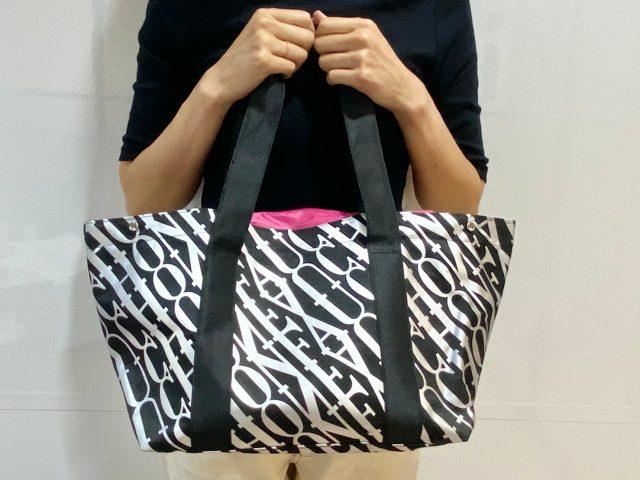 FAUCHONショッピングバッグを持った女性